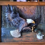 Relief Carving in Wood of Bald Eagle Fishing